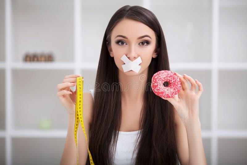 Unhealthy eating. Junk food concept. Girl don`t eat junk food.  stock photos