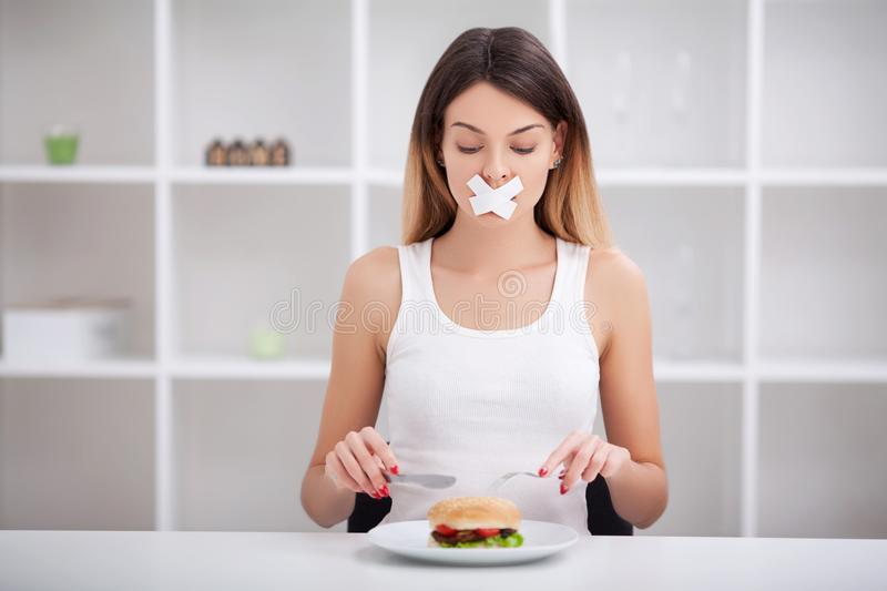 Unhealthy eating. Junk food concept. Girl don`t eat junk food.  stock image