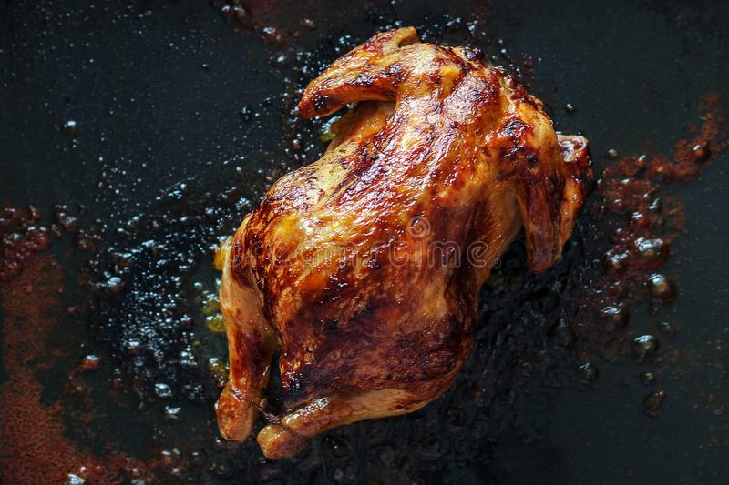 Unhealthy fatty foods. chicken baked in the oven floats in fat. cholesterol, carcinogens, and unhealthy diet stock images