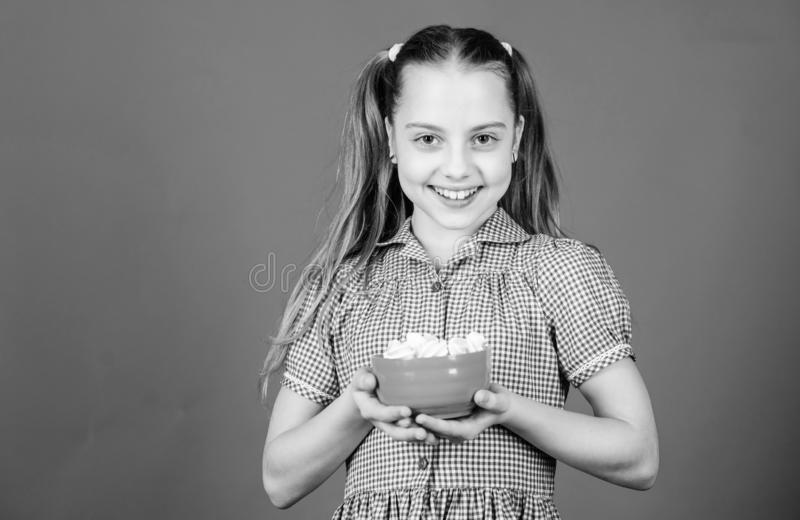 Unhealthy food. Dieting and calorie. Sweet tooth concept. Healthy food and dental care. happy little child love sweets. And treats. Small girl eat marshmallow royalty free stock image