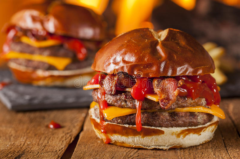 Unhealthy Homemade Barbecue Bacon Cheeseburger. With Fries stock photo