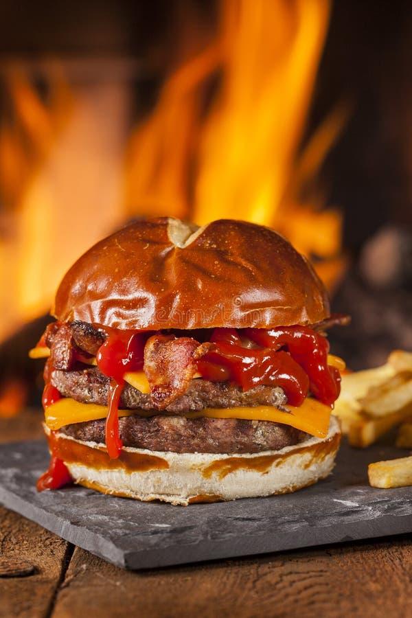 Unhealthy Homemade Barbecue Bacon Cheeseburger Stock Images