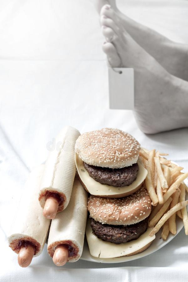 Unhealthy junk fast food and death body in morgue abstract of bad life style. Concept stock photography