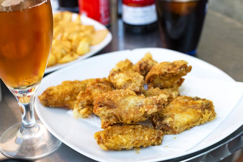 Unhealthy lifestyle Unhealthy food and drink on the table. Unhealthy lifestyle. Fried food with saturated fats and carbonated drink stock images