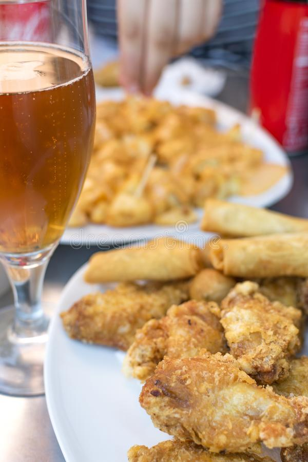 Unhealthy lifestyle Unhealthy food and drink on the table. Unhealthy lifestyle. Fried food with saturated fats and carbonated drink royalty free stock photos