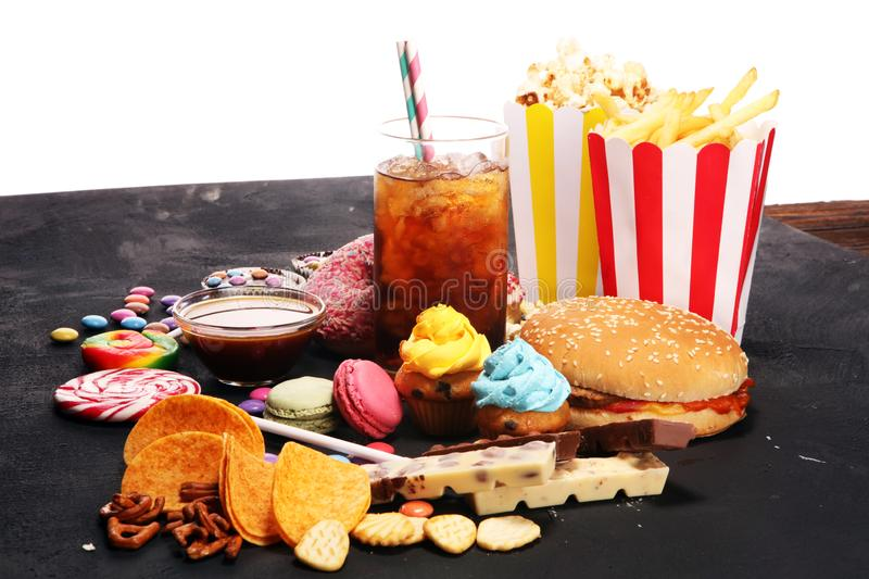 Unhealthy products. food bad for figure, skin, heart and teeth. Assortment of fast carbohydrates food royalty free stock images