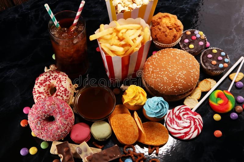 Unhealthy products. food bad for figure, skin, heart and teeth. Assortment of fast carbohydrates foo.d stock photos