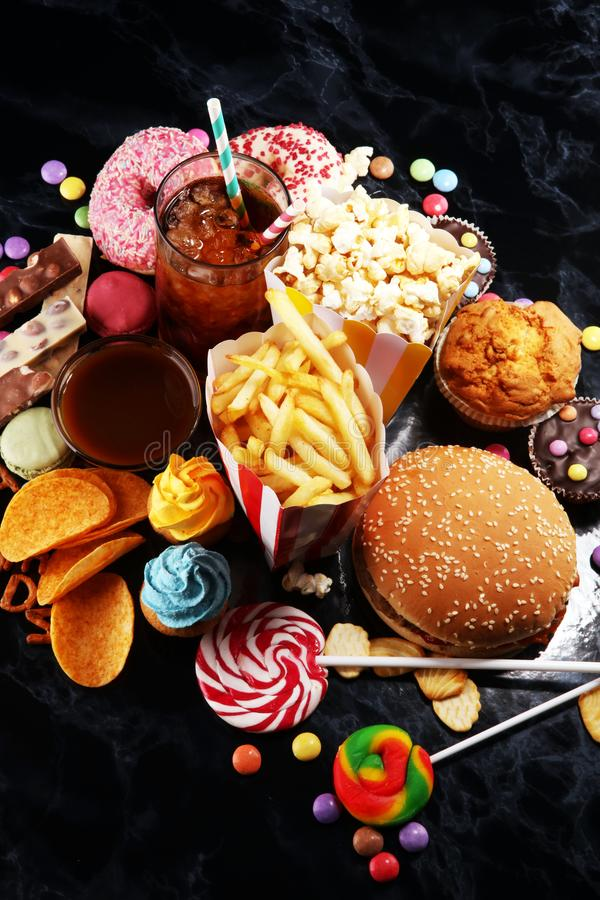 Unhealthy products. food bad for figure, skin, heart and teeth. Assortment of fast carbohydrates food royalty free stock photo