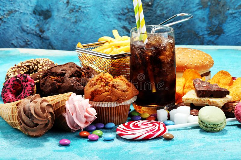 Unhealthy products. food bad for figure, skin, heart and teeth. royalty free stock photos