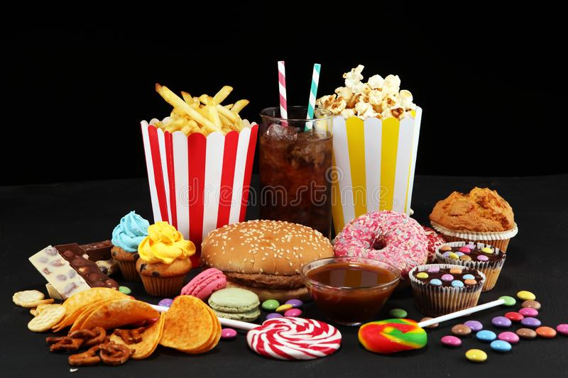Unhealthy products. food bad for figure, skin, heart and teeth. Assortment of fast carbohydrates foo.d stock photo