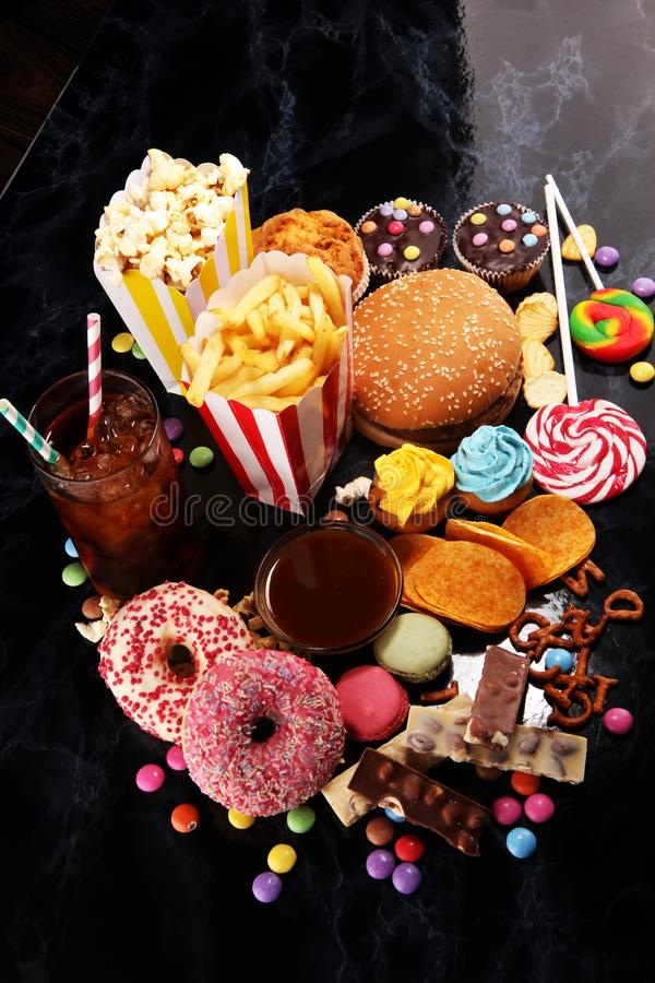 Unhealthy products. food bad for figure, skin, heart and teeth. Assortment of fast carbohydrates foo.d royalty free stock image