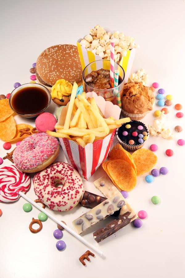 Unhealthy products. food bad for figure, skin, heart and teeth. Assortment of fast carbohydrates food royalty free stock photography