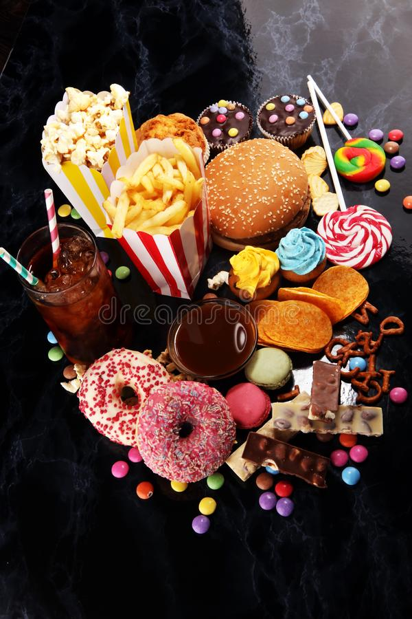 Unhealthy products. food bad for figure, skin, heart and teeth. Assortment of fast carbohydrates food stock photography