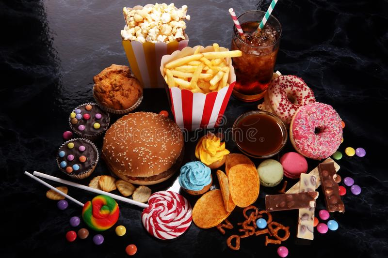 Unhealthy products. food bad for figure, skin, heart and teeth. Assortment of fast carbohydrates food stock images