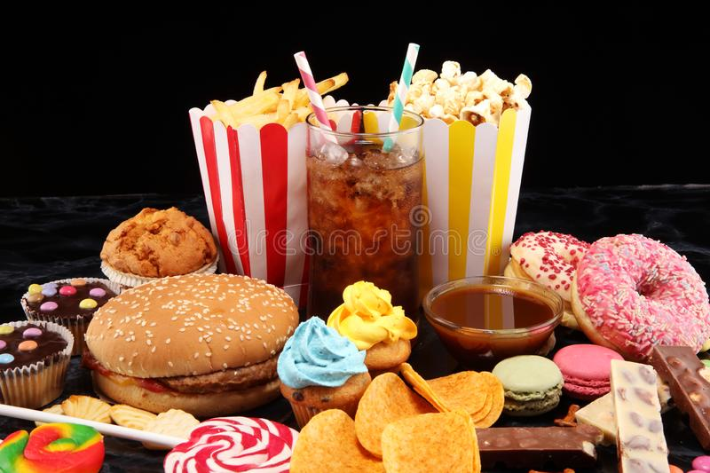 Unhealthy products. food bad for figure, skin, heart and teeth. Assortment of fast carbohydrates food stock photo