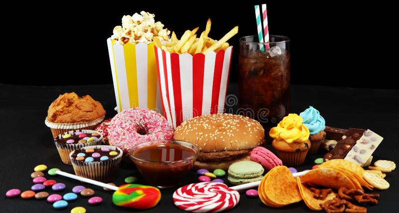 Unhealthy products. food bad for figure, skin, heart and teeth. Assortment of fast carbohydrates food stock image