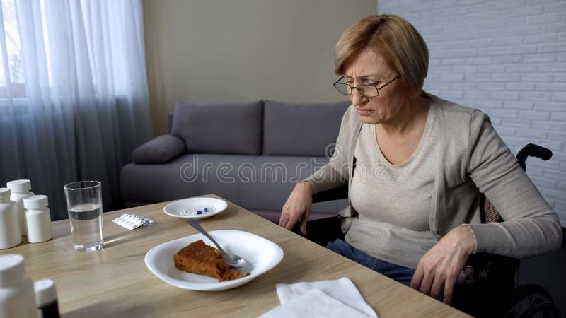 Unhealthy senior woman feeling pain in nursing home, refusing to eat, old age royalty free stock images