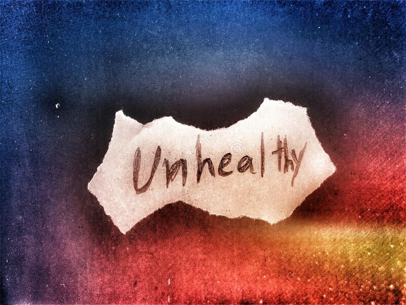 The unhealthy word written on the white color cut paper on the dark background art royalty free stock photo