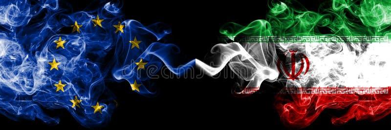 União Europeia contra Irã, bandeiras iranianas do fumo colocadas de lado a lado Bandeiras de seda coloridas grossas do fumo da  ilustração do vetor