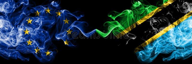 Unia Europejska vs Tanzania, tanzańczyka dymu flaga umieszczająca strona strona - obok - Gęste barwione silky dymne flagi UE i royalty ilustracja