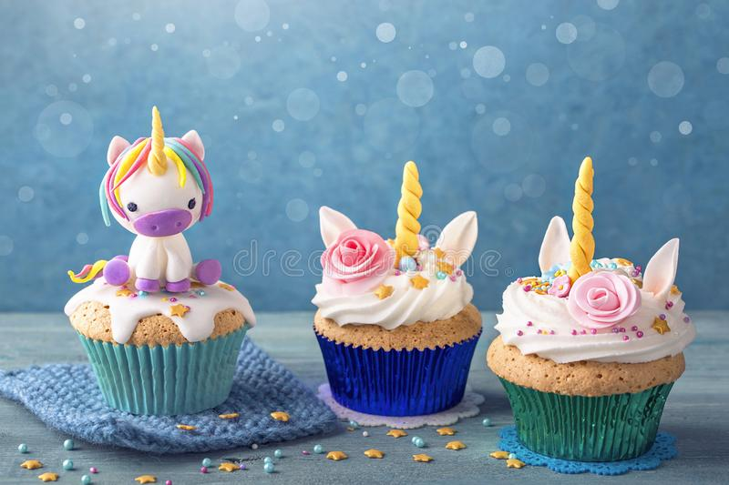 Unicorn cupcake for a party. Unicorn cupcake on a blue background royalty free stock photos
