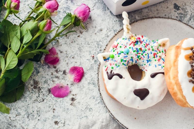 Unicorn donut with white glaze royalty free stock photography