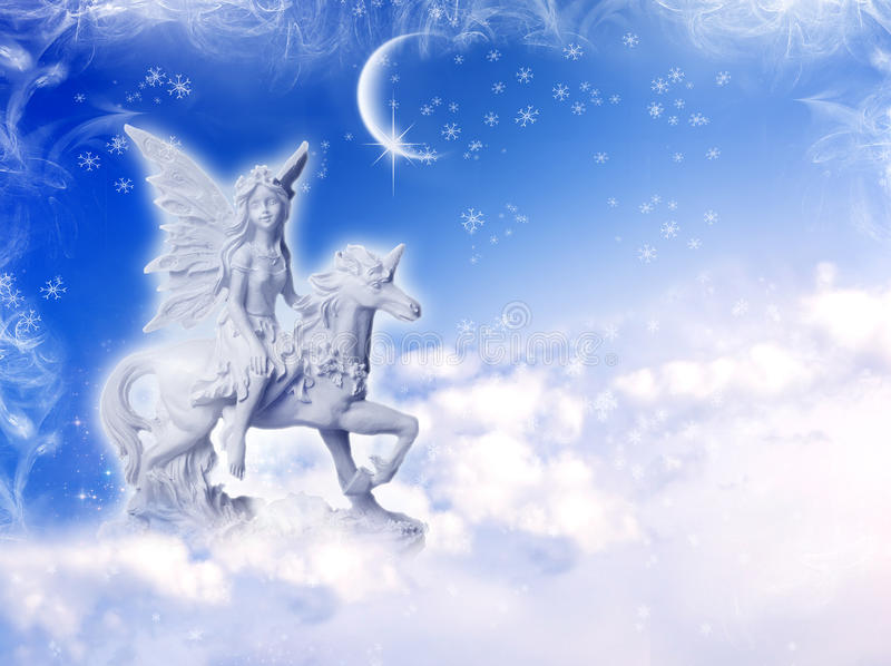Unicorn with a fairy stock photo