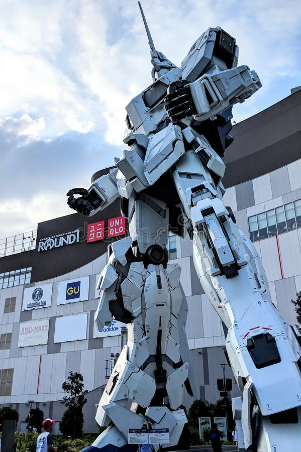 The 1:1 Unicorn Gundam Statue standing tall outside of Diver City Mall in Tokyo, Japan. stock photo