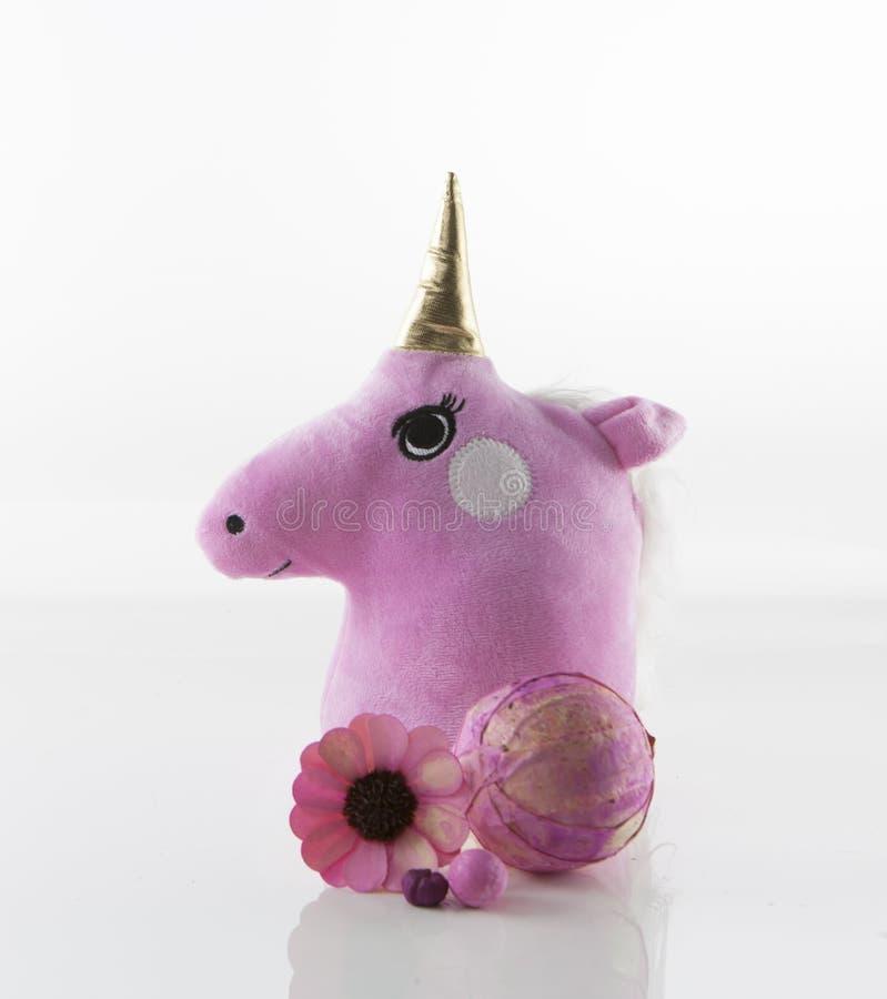 Unicorn Head mignon avec des fleurs photo stock