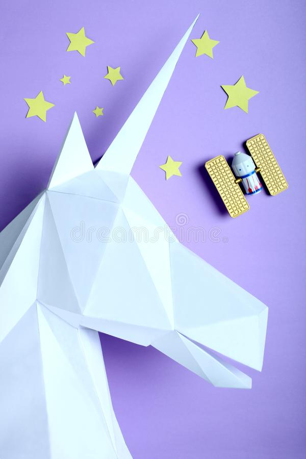 Unicorn made of paper and satellite royalty free stock images