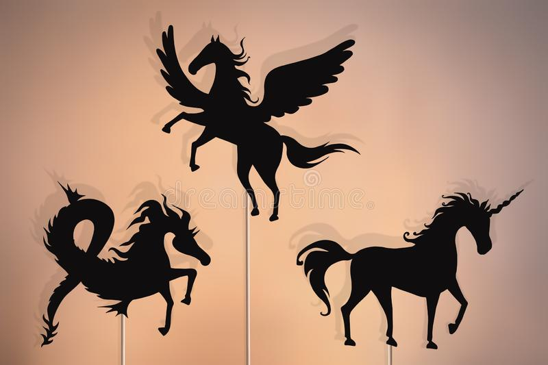 Unicorn, Pegasus and Sea horse shadow puppets stock photography