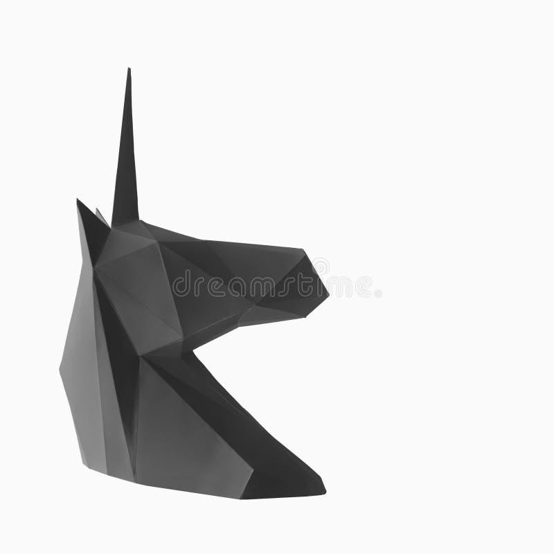Unicornio de papel negro en un fondo blanco Espacio para el texto fotografía de archivo libre de regalías