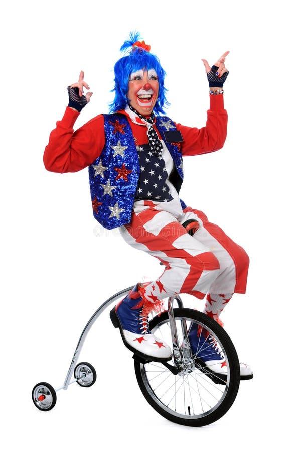 unicycle riding клоуна стоковое фото rf