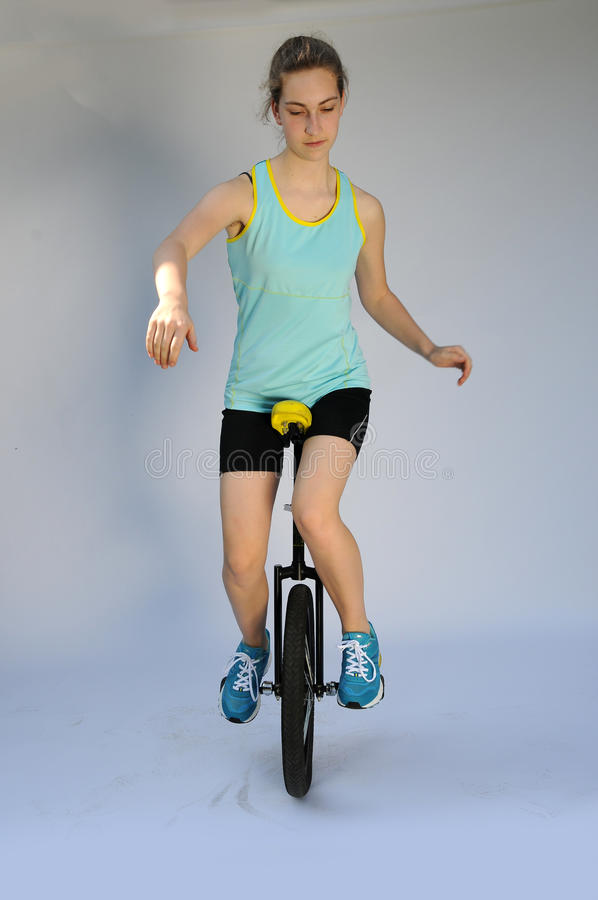 Unicyclist. Sportive teenager girl with unicycle royalty free stock image