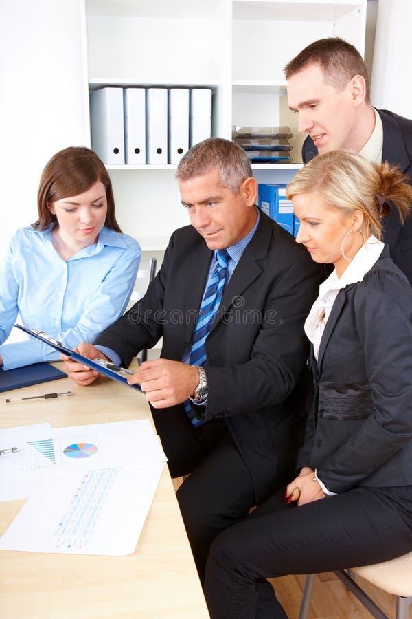 Unidad de negocio en la reunión imagenes de archivo