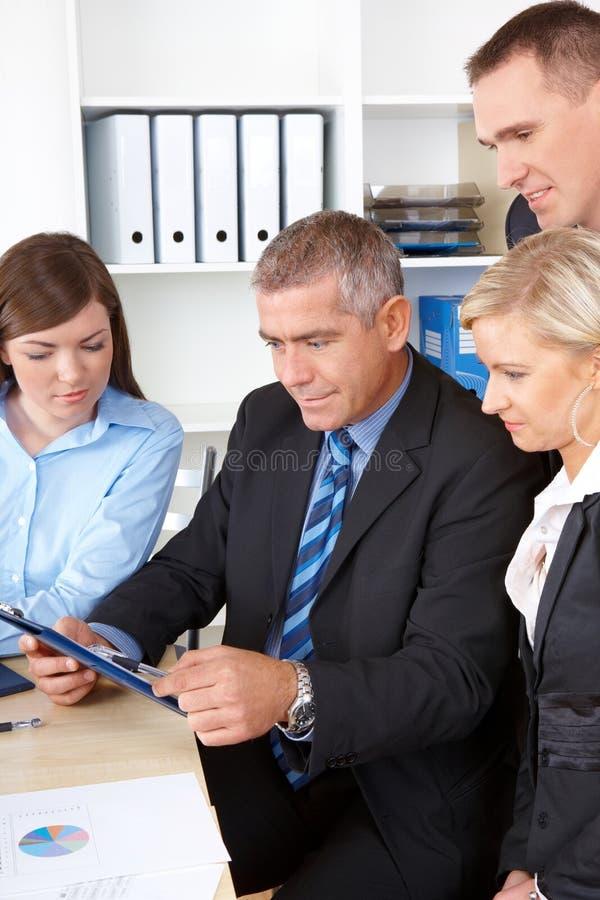 Unidad de negocio en la reunión foto de archivo