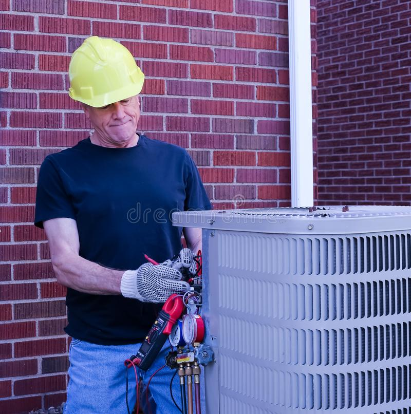 Unidade da ATAC de Services do reparador do condicionamento de ar fotos de stock