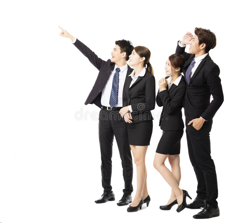 Unidade de negócio feliz que aponta e que olha acima foto de stock royalty free