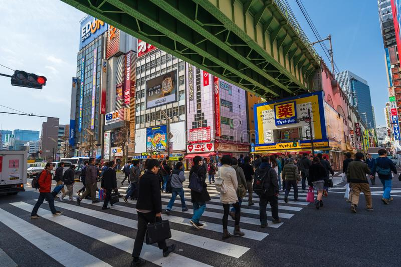 Unidendified people walk across the street in Akihabara at Tokyo, Japan. Akihabara, JAPAN - March 25, 2019: unidendified people walk across the street in stock images