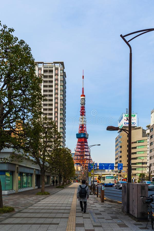 Unidendified people walk across the street in Tokyo city, Japan. TOKYO, JAPAN - March 25, 2019: Unidendified people walk across the street in Tokyo city, Japan stock photography