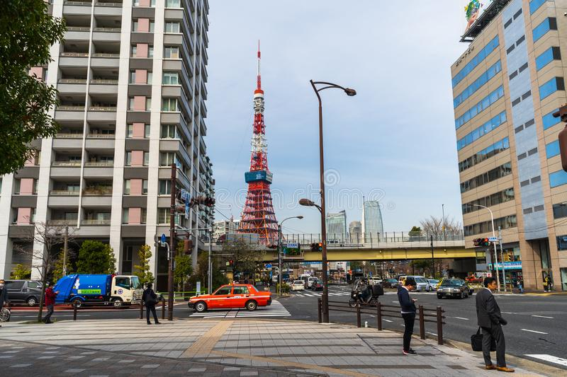 Unidendified people walk across the street in Tokyo city, Japan. TOKYO, JAPAN - March 25, 2019: Unidendified people walk across the street in Tokyo city, Japan stock photos
