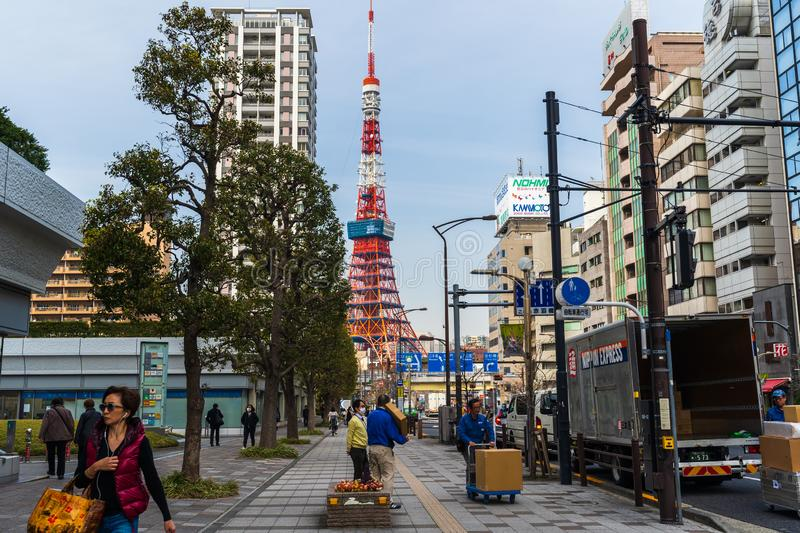 Unidendified people walk across the street in Tokyo city, Japan. TOKYO, JAPAN - March 25, 2019: Unidendified people walk across the street in Tokyo city, Japan stock images