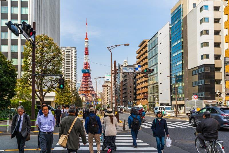 Unidendified people walk across the street in Tokyo city, Japan. TOKYO, JAPAN - March 25, 2019: TOKYO, JAPAN - March 25, 2019: Unidendified people walk across stock images