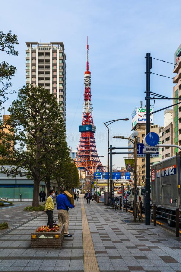 Unidendified people walk across the street in Tokyo city, Japan. TOKYO, JAPAN - March 25, 2019: Unidendified people walk across the street in Tokyo city, Japan stock image