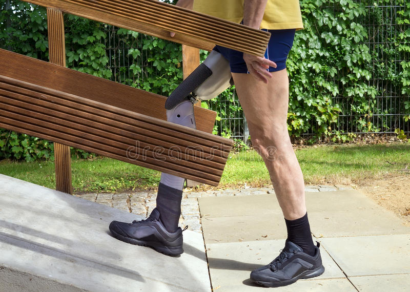 Unidentifiable man walking on ramp with false leg for exercise. stock images