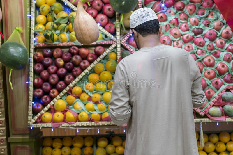 Unidentified Arabian man on the street sell local vegetable and fruits. man selling vegetables on a market. Arab man in the bazaar stock photo
