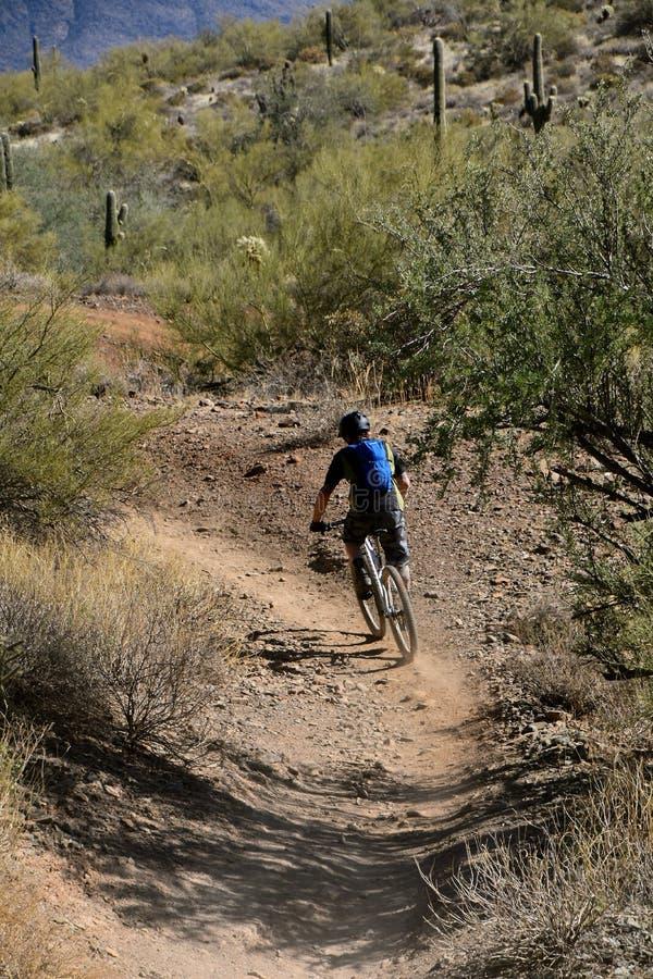Biker on rocky trail stock photos
