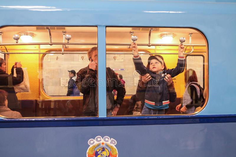 Unidentified child opens a window in an old subway car royalty free stock photo