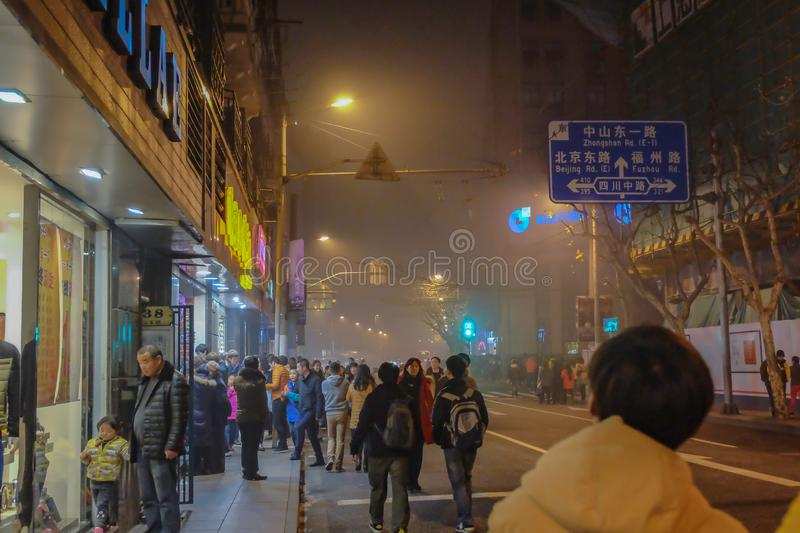 Unidentified Chinese People walk to the bund shanghai china. Shanghai/China - January 25 2015: Unidentified Chinese People walking to the bund shanghai china in stock photos