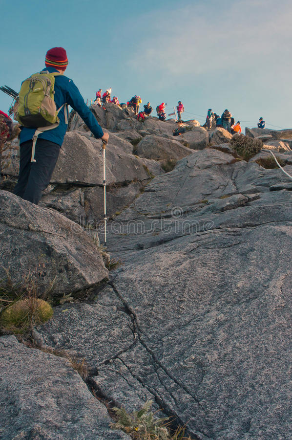 Unidentified climber passing trail to the summit of Mount of Kinabalu royalty free stock photo